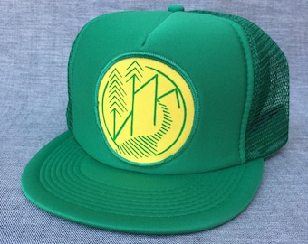 UNS Nature design. Trucker hat w/patch.