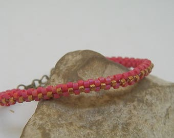 Red and bronze hand-woven bracelet