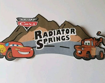 Disney Scrapbook page title Radiator Springs Tow mater and Lightining McQueen