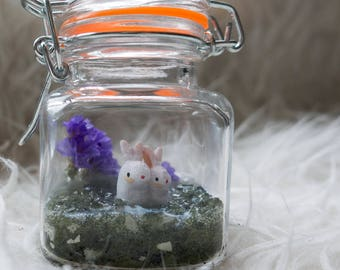 "Little pair of white bunnies in a 2"" jar"