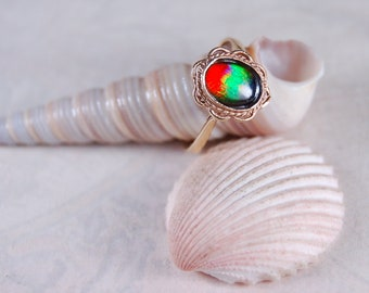 Dainty Feminine Ammolite ring in gold.Gorgeous colours.Leaves a BIG impression.#042918