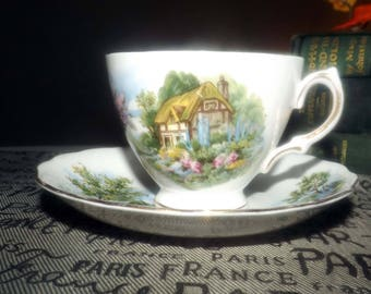 Mid-century (c.1950s) Royal Vale (Ridgway Potteries) pattern 7382 Country Cottage tea set (footed cup w/matching saucer). Gold edge, accents