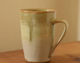 Pottery Coffee Mug, Hot Cocoa Mug, Coffee Cup by Fire Garden Pottery. 12 oz pottery mug. Matte Green and Cream Glazes.