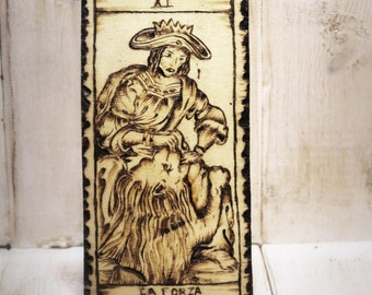 The Strength, a tarot on wood with pyrography