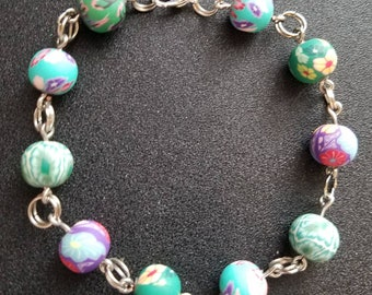 Blue and purple floral polymer clay beaded bracelet