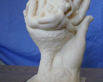 Hand of God by Rodin. Santini sculpture. Italy