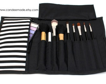 Black and white striped Brush Roll With Zippered Pocket.