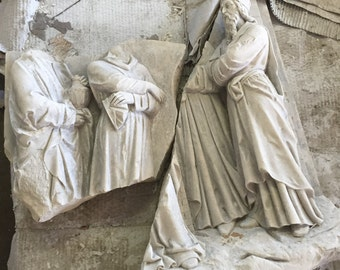 Figurines from an Antique Stone Station of the Cross from St. James Church in Chicago Illinois, built in 1875