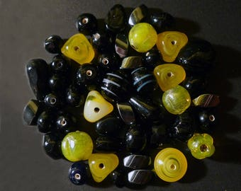 Black, yellow various forms of hematite and glass Indian beads