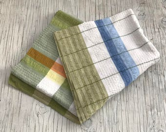 Picnic cloth. Green, blue, yellow and orange blue and green design. 46 inches square. Dining tablecloth.