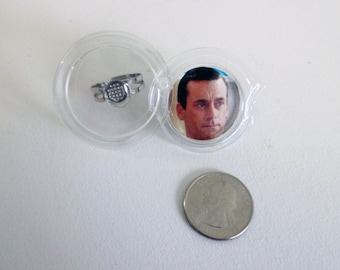 Hard to Explain John Hamm Ring that Also Holds a Quarter