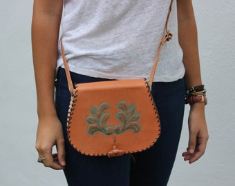 embossed and hand-sewn leather bag