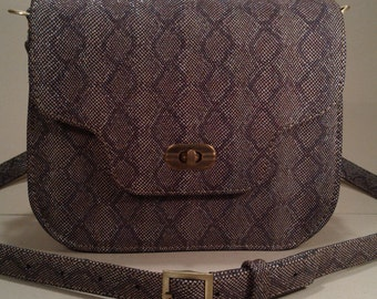 Clutch or mini handbag made of genuine leather under the python.
