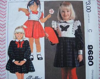 vintage 1980s simplicity sewing pattern 8680 girls dress and detachable bib size 4 uncut