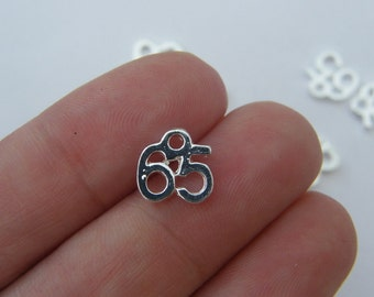8 Number 65 charms silver plated