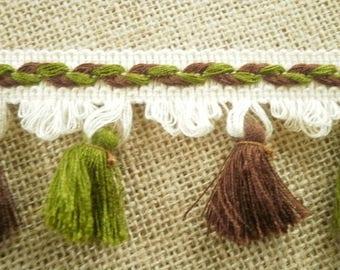 "Lace fringe ""tassels"" made of dralon, tones: off-white, embroidered with Brown and green background, 5.6 cm wide"
