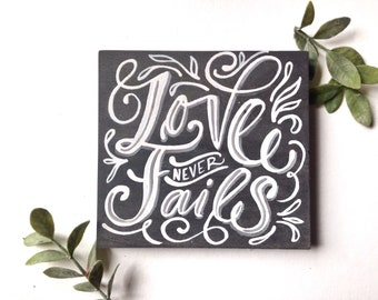 """Love never fails 6""""x6"""" hand painted wood sign"""