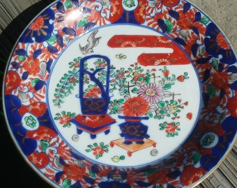 Very rare 18th century Japanese Imari porcelain dish with flowers and floral motifs planters and birds flying. 1700 to 1800 AD