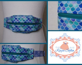 Turquoise glitter mermaid scales insulin pump belt with blue and white snowflake elastic.  Size 1.