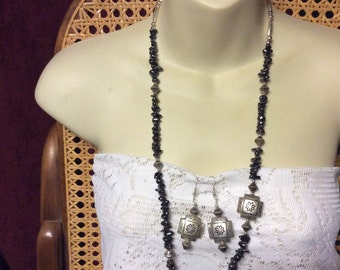 Hematite bead chunks silver metal tribal look necklace and earrings set.