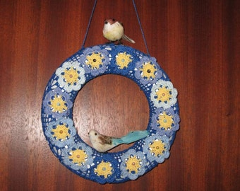 Door wreath with flowers and birds