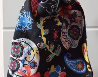 Black bag with coloured skulls with ropes and ruched clasp
