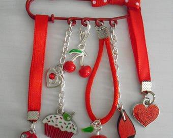 Pretty little red brooch!