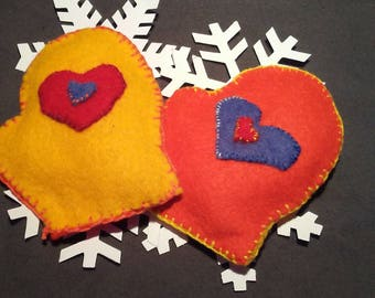 Mitten shaped wool felt hand warmers with embroidered felt hearts