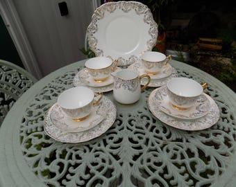 Crown, Staffordshire 22ct gold embellished 14pc tea set