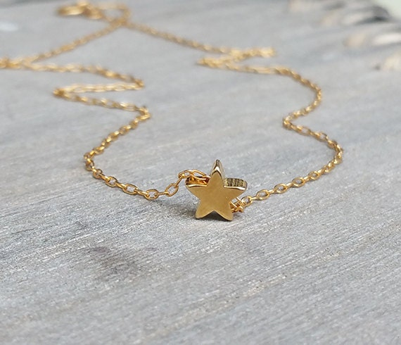 Tiny star necklace goldfilled star necklace star pendant like this item mozeypictures Image collections