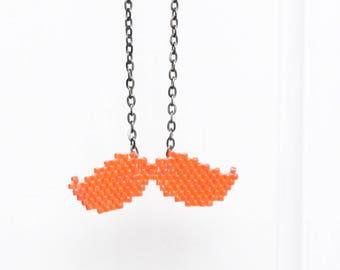 Hand woven orange mustache necklace