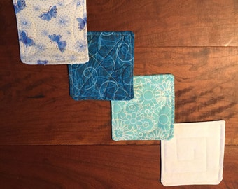 Set of blue/teal/white coasters