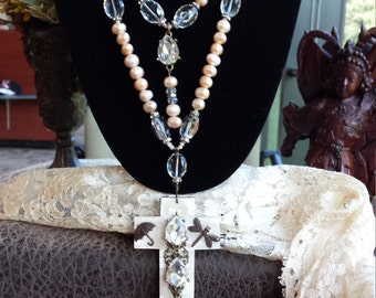 Two strand fresh water pearl necklace with shell cross pendant