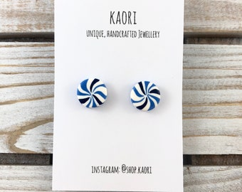 Polymer clay stud earrings in blue and white candy stripe