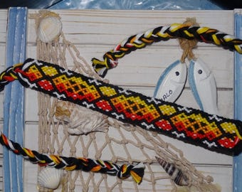 Friendship Bracelet, ombre color fire on a black background