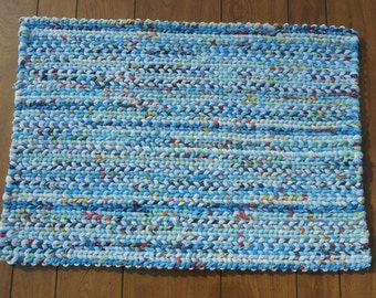 Blues and white with flecks of other colors rectangular twined rag rug