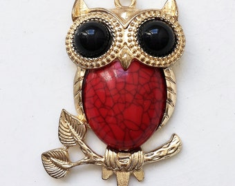 recycled gold tone metal owl pendant with faux red gemstone tummy and black rhinestone eyes