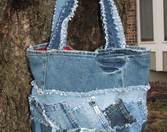 Denim tote bag. Made using the watch pockets and pieces from multiple pairs of recycled denim jeans. Patchwork, clipped and frayed.