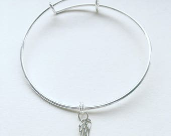 Sterling silver expanding bracelet with wing charm