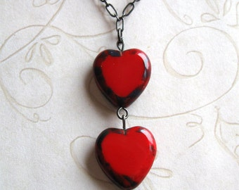 Two red hearts necklace with red Czech glass beads