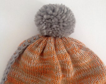 Children knitted hat with PomPoms