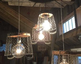 Chicken wire basket barnwood chandelier.
