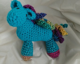Cute little blue pony with a bit of sparkle, with rainbow mane and tail. Soft crocheted handmade horse toy. Ready to ship.