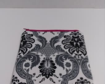 Gray, black, & white pouch with a pink zipper