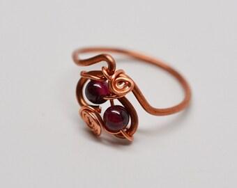 Copper & garnet swirling teardrops wirework ring
