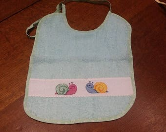 Pale green Terry bib embroidered snails