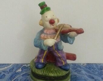 Clown curio box playing violin