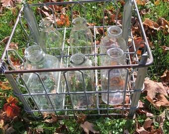 Vintage milk crate wirh bottles