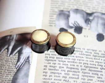 "Pair of plugs / tunnels 14 mm (9/16 "") and Golden Pearl button"