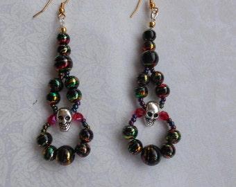 Earrings with skulls.